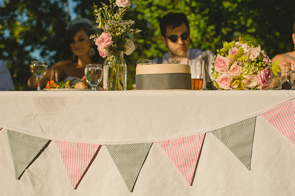 Pink and green bunting as head table decor - Photo by Nordica Photography