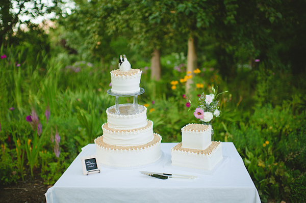 Square and round wedding cakes with bride and groom cake topper ...