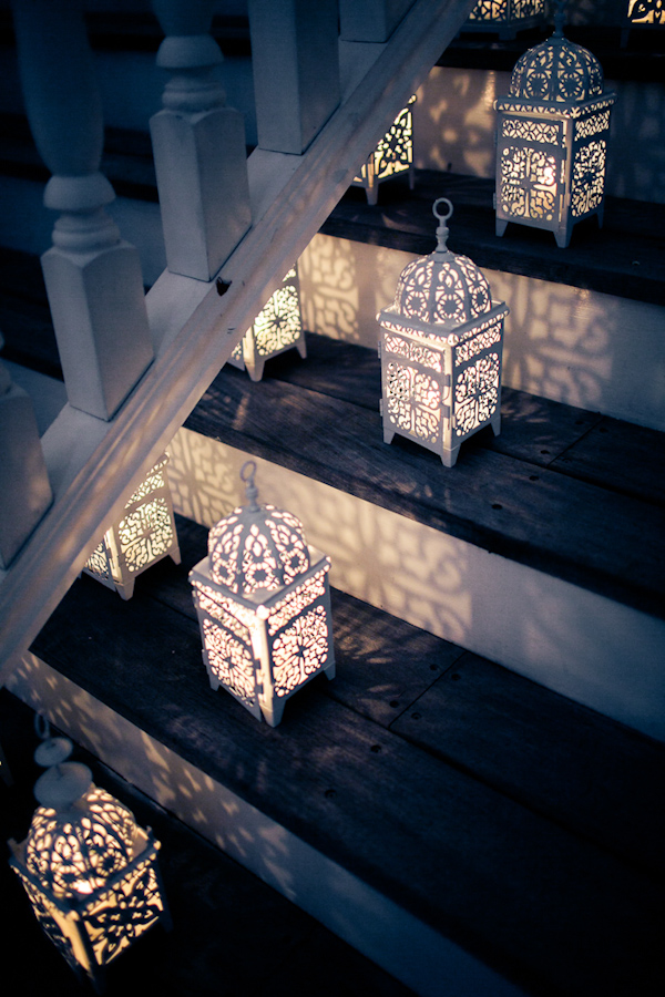 Decorative white lanterns for evening wedding reception - Photo by Sarah Tew Photography