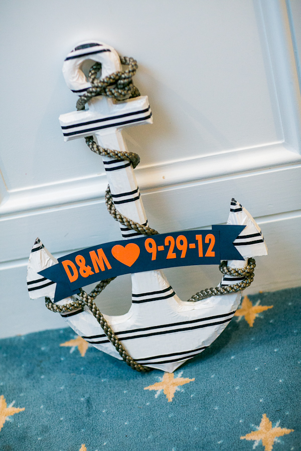 Navy, orange and white nautical-inspired anchor with couple's initials and wedding date - Photo by Sarah Tew Photography