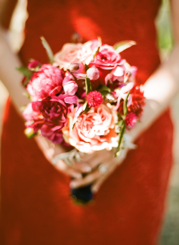 Colorful bridesmaid bouquet featuring shades of pink and red - Photo by Sylvie Gil Photography