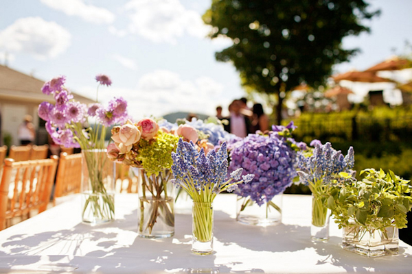light blue, lavender and pink flowers on table - preppy New York Sagamore resort wedding photo by New York wedding photographer Tracey Buyce