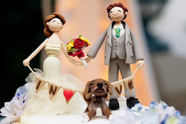 cute sculpted cake topper of the couple and their dog - preppy New York Sagamore resort wedding photo by New York wedding photographer Tracey Buyce