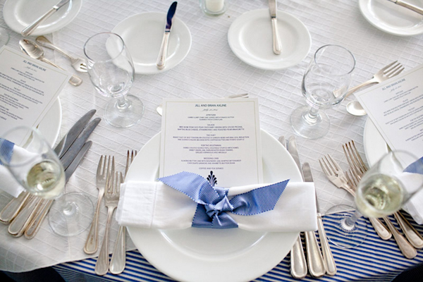 table setting with menu and napkin tied with light blue ribbon - preppy New York Sagamore resort wedding photo by New York wedding photographer Tracey Buyce