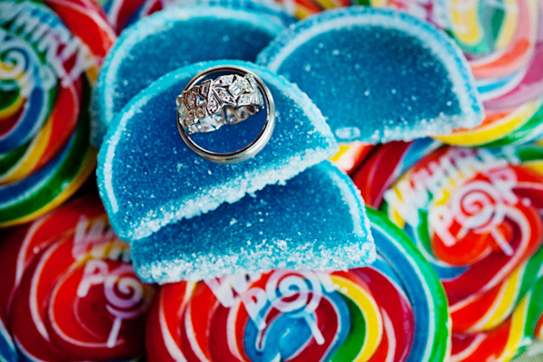rings rest on colorful candy at the candy bar - preppy New York Sagamore resort wedding photo by New York wedding photographer Tracey Buyce