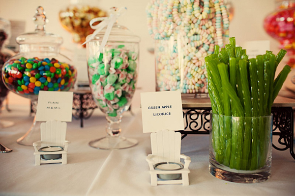 cute candy bar with hand written signs and candles - preppy New York Sagamore resort wedding photo by New York wedding photographer Tracey Buyce