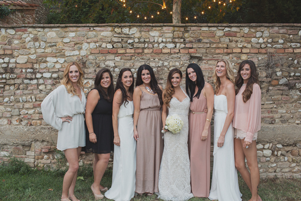 Beautiful bride and bridesmaids wearing neutral shades of blush, nude, white and black - Photo by Whitewall Photography