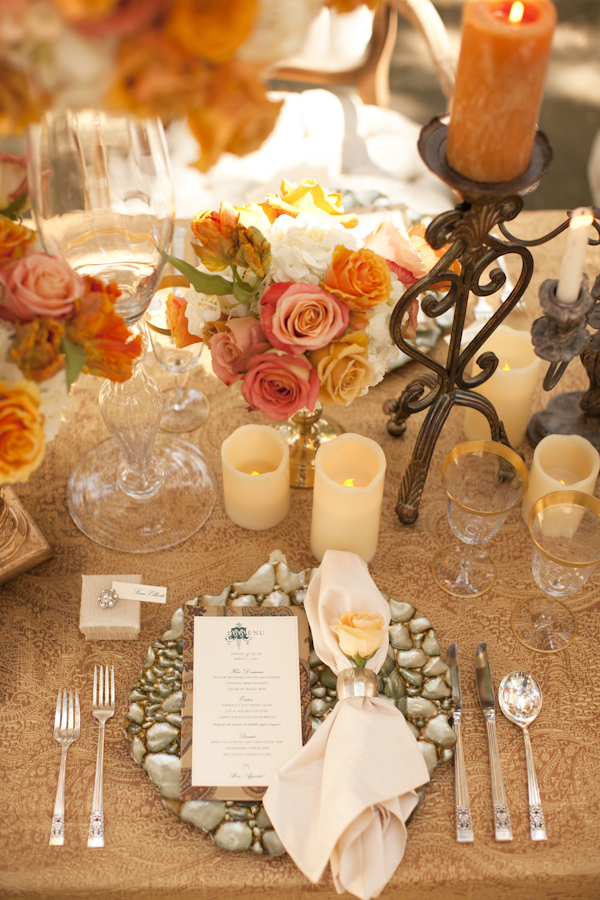 Table Setting With Orange Champagne And Tan Flowers Candles Wedding Decor Inspiration Shoot