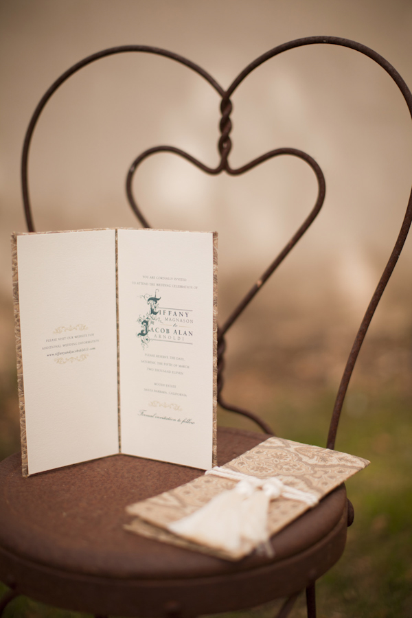 tan program sits on vintage chair - wedding decor inspiration shoot - wedding invitation designed by Zenadia Designs