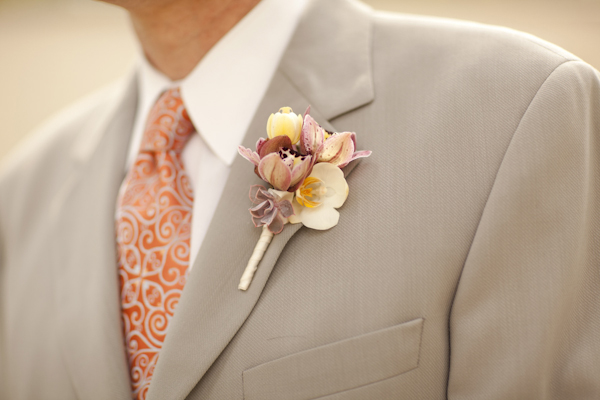 brown and tan boutonniere on tan suit with orange tie - wedding decor inspiration shoot - wedding invitation designed by Zenadia Designs