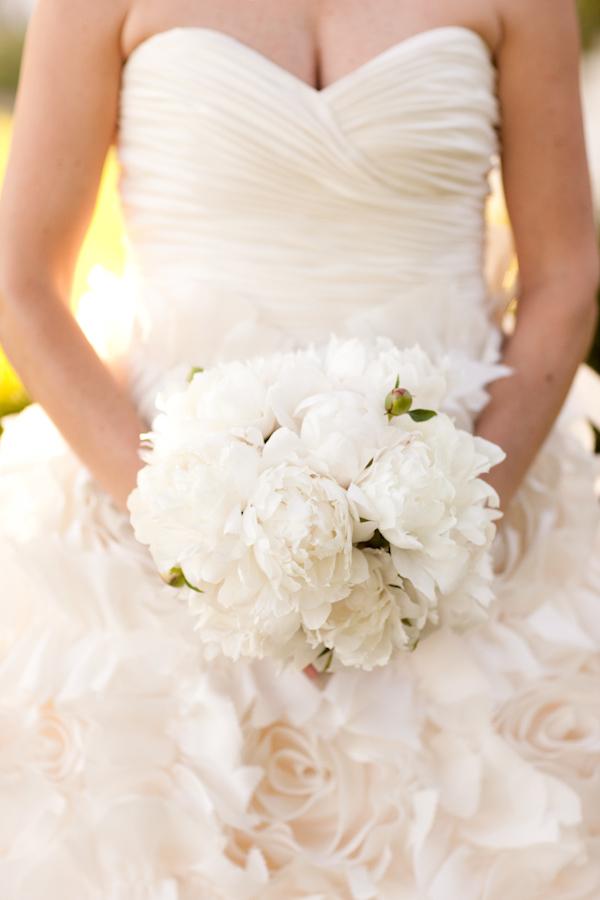 Bride Wearing An Ivory Strapless Sweetheart Cut Ruffle Wedding