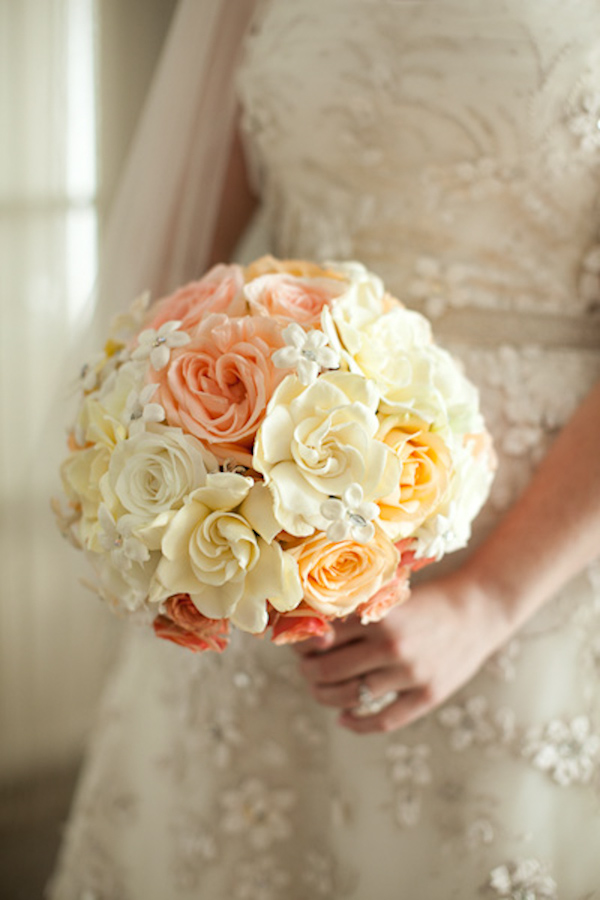 bride holding a white, ivory, and peach rose bouquet - photo by Washington DC wedding photojournalist Paul Morse