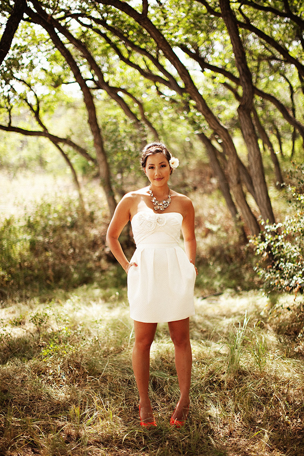 the beautiful bride poses for a portrait in the trees - photo by Dallas based destination wedding photographer Poser