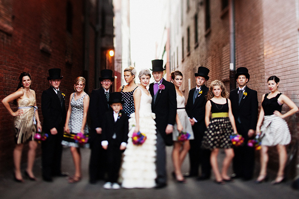 The Happy Couple Poses With The Wedding Party For A Group Portrait
