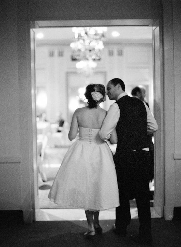 Couple walking into reception in black and white - wedding photo by top Austin based wedding photographers Q Weddings