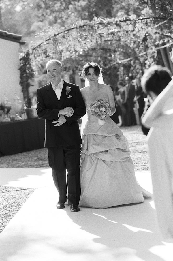 Black and white photo of father walking bride down the aisle - wedding photo by top Austin based wedding photographers Q Weddings
