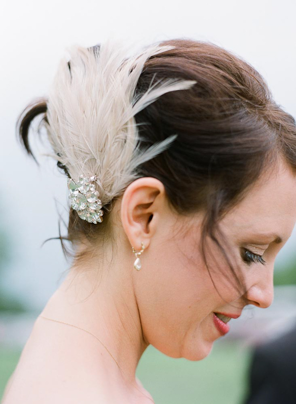 Lovely ivory and feathered bridal hair accessory - wedding photo by top Austin based wedding photographers Q Weddings