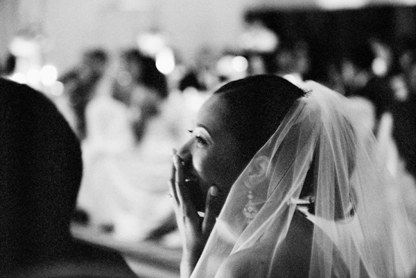 Reception bridal laughter and veil - wedding photo by top Austin based wedding photographers Q Weddings