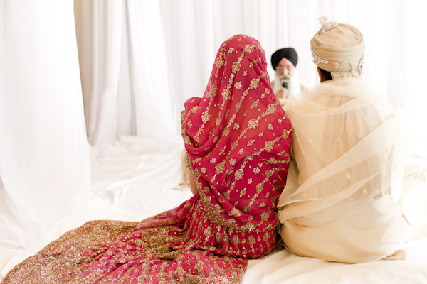 East Indian bride and groom sitting together- wedding photo by top Canadian wedding photographer Rebecca Wood