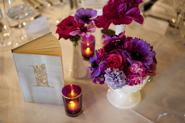 reception table top decorations, candles, flowers, books- wedding photo by top Canadian wedding photographer Rebecca Wood