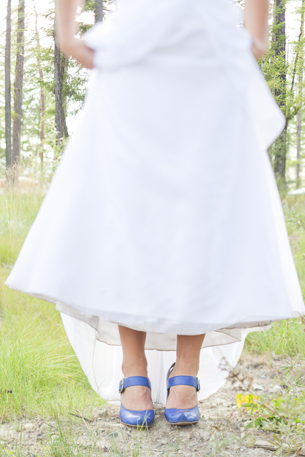 Bride lifts her dress so you can see her shoes- wedding photo by top Canadian wedding photographer Rebecca Wood