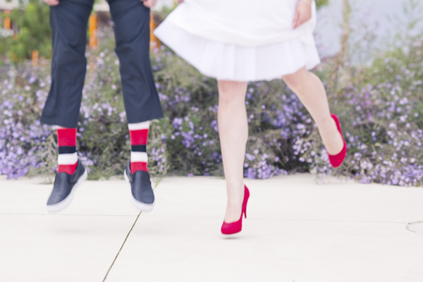 Bride and groom jump- wedding photo by top Canadian wedding photographer Rebecca Wood