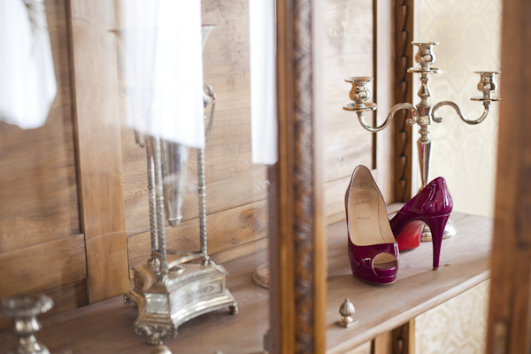 Bride's Shoes in the display case- wedding photo by top Canadian wedding photographer Rebecca Wood