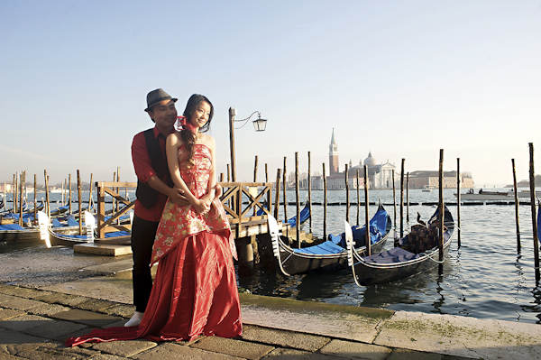the happy couple standing on the waterfront - wedding photo by top Rome based destination wedding photographer Rochelle Cheever, Rome Weddings Photography