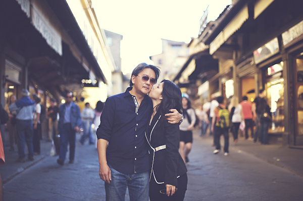 urban engagement photo -  affectionate couple - wedding photo by top Rome based destination wedding photographer Rochelle Cheever, Rome Weddings Photography