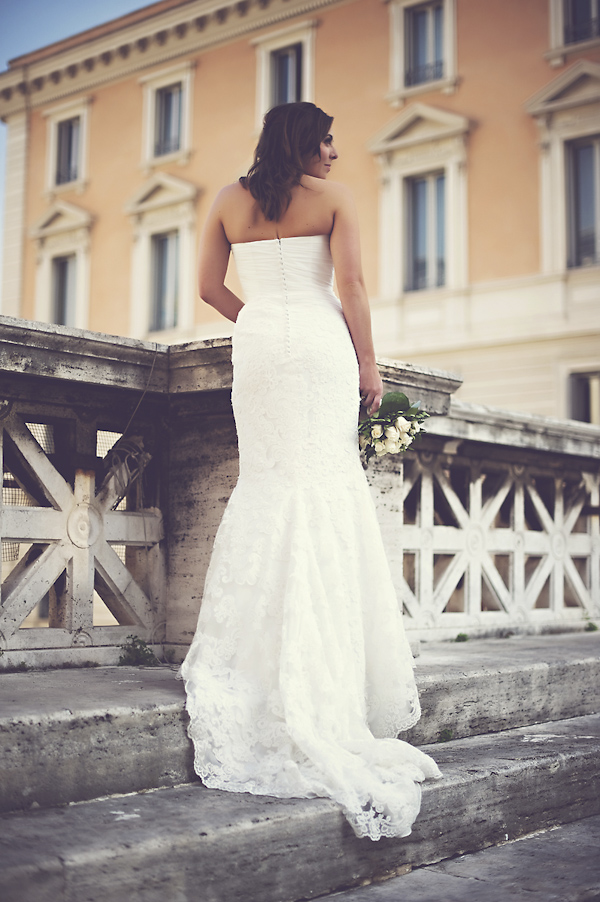 happy bride standing on bridge - mermaid wedding dress - wedding photo by top Rome based destination wedding photographer Rochelle Cheever, Rome Weddings Photography