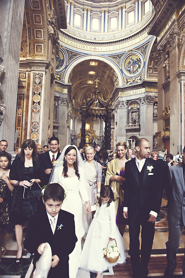 newlywed walking amidst friends and family - wedding photo by top Rome based destination wedding photographer Rochelle Cheever, Rome Weddings Photography