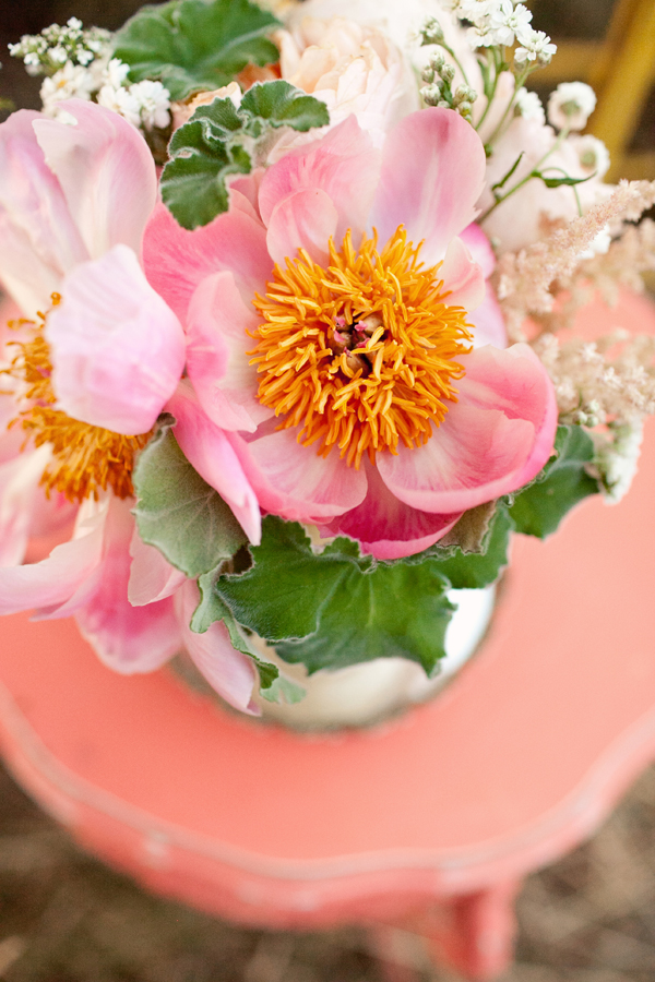 Vibrant pink and orange floral decor - Photo by Studio 6.23