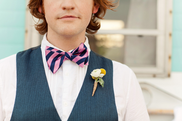 Modern pink and navy bow tie paired with yellow and white vintage inspired boutonniere - Photos by Studio 6.23