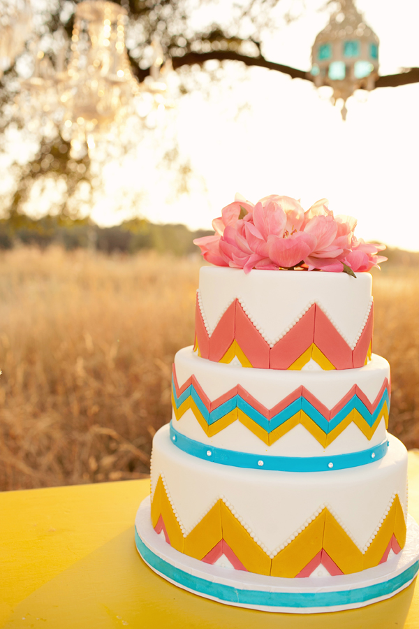 Colorful and creative wedding cake with zig zag print and pink flowers - Photo by Studio 6.23