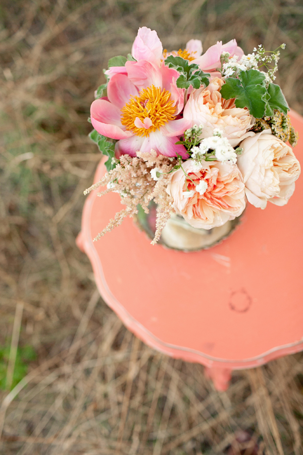 Pretty pink flower arrangement on vintage inspired coral side table - Photo by Studio 6.23