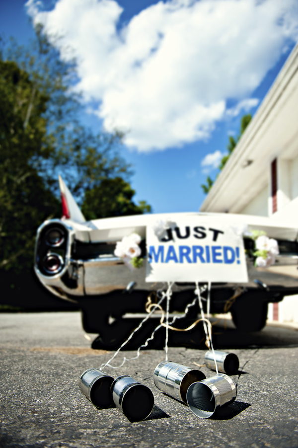 "sign reading ""just married"" on a car with tin cans attached - wedding photo by top Atlanta based wedding photographers Scobey Photography"