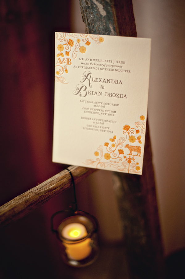 detail of a orange and yellow wedding program - hanging candle - wedding photo by top Atlanta based wedding photographers Scobey Photography