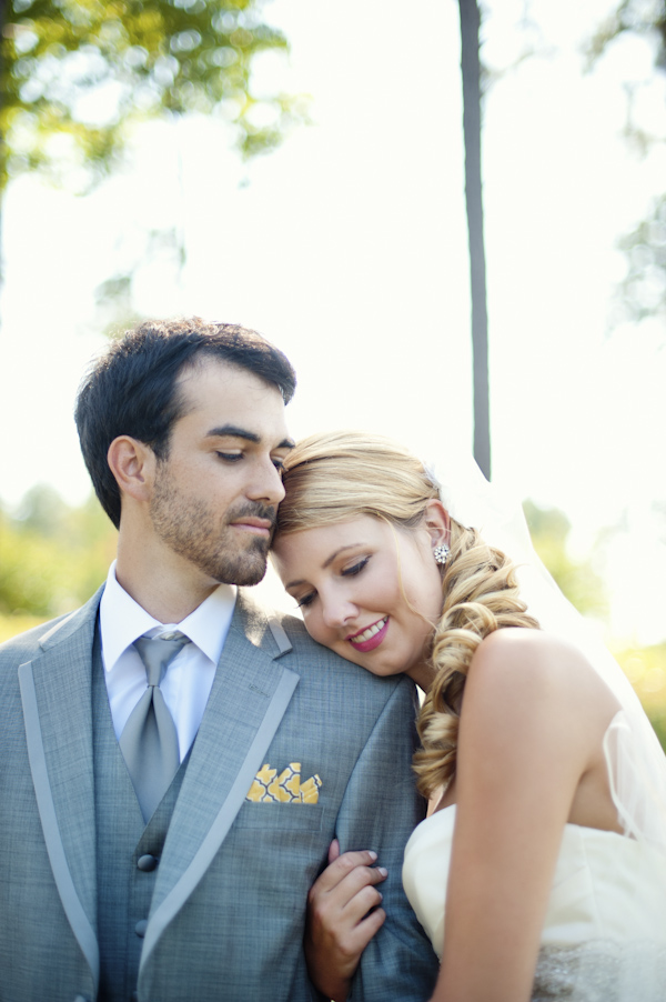 bride and groom in grey suit together outside - wedding photo by top Atlanta based wedding photographers Scobey Photography