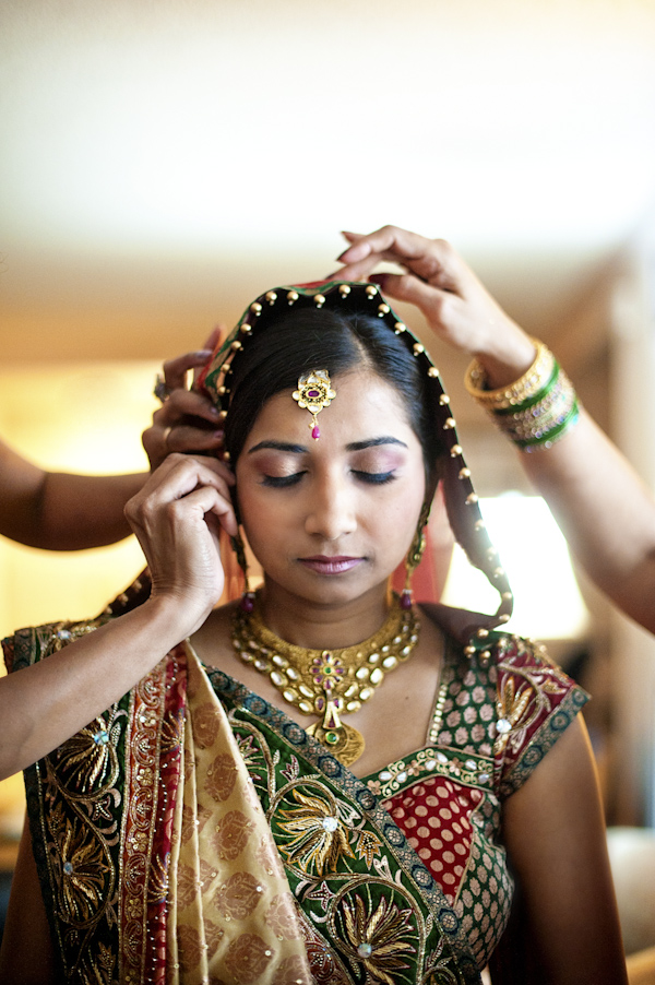 Indian bride getting ready in traditional wedding attire - wedding photo by top Atlanta based wedding photographers Scobey Photography