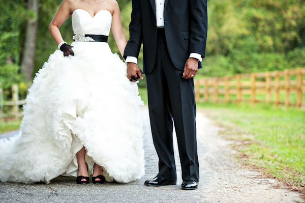Detail Shot Of White And Black Bridal Dress And Shoes And Groom S