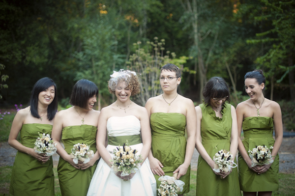 Bride And Bridesmaids In Chartreuse Laugh While Posing For Photos