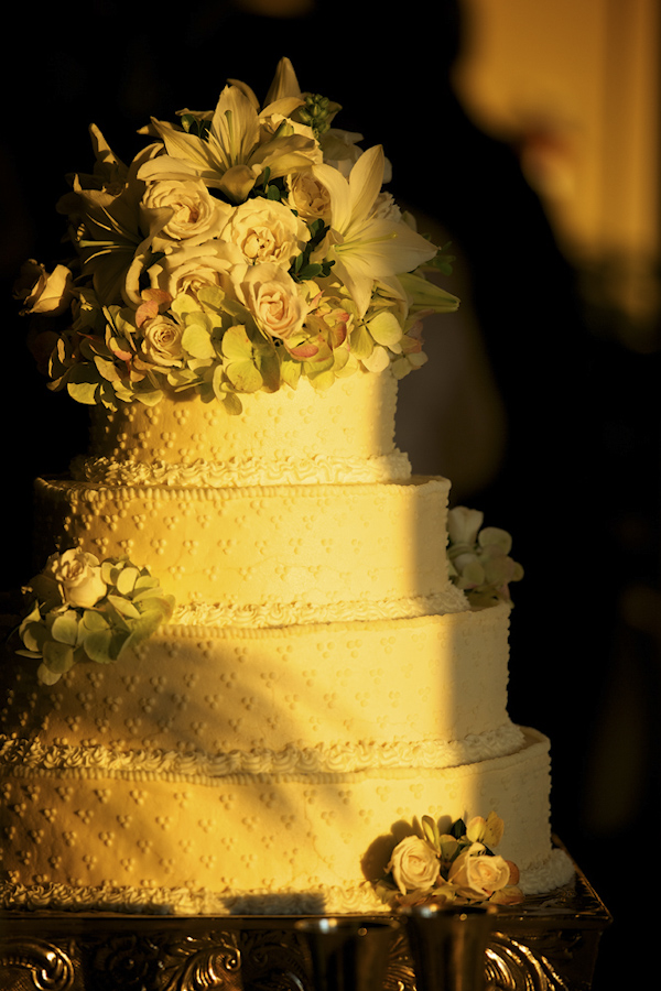 White wedding cake with white floral cake topper - photo by top Atlanta-based wedding photographer Scott Hopkins Photography