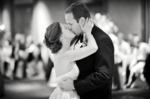 The newlyweds share a kiss - wedding photo by top Atlanta-based wedding photographer Scott Hopkins Photography