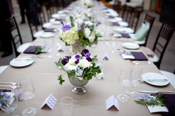 Reception Dinner Table Setting Tan Tablecloth Purple Napkins Folded With Fl Accents