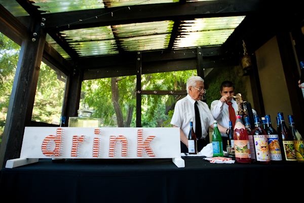 drink station with a white and read sign reading