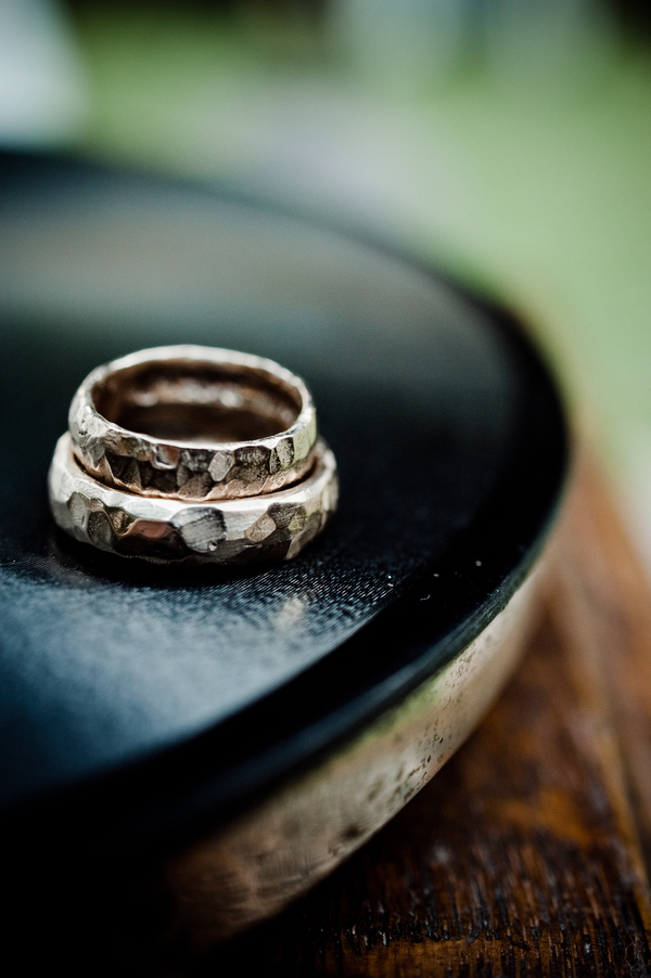 wood inspired rings rest on a record - music inspired DIY wedding - photos by top Orange County, CA wedding photographers Viera Photographics