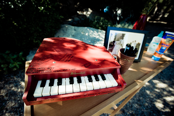 red mini piano serves as guestbook - music inspired DIY wedding - photos by top Orange County, CA wedding photographers Viera Photographics