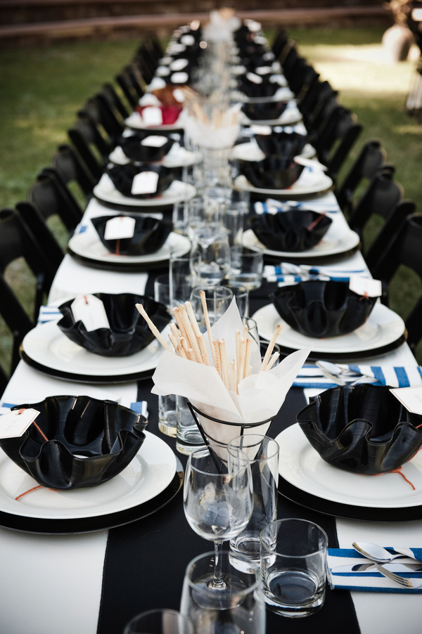 Black and white long tables with record bowl favors for Black table centrepieces
