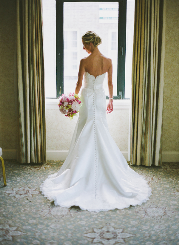 bride poses in front of window in mermaid dress - sweet southern military style wedding photo by Charleston wedding photographer Virgil Bunao
