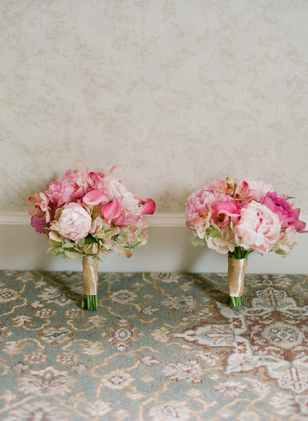 light pink and dark pink bouquets side by side - sweet southern military style wedding photo by Charleston wedding photographer Virgil Bunao